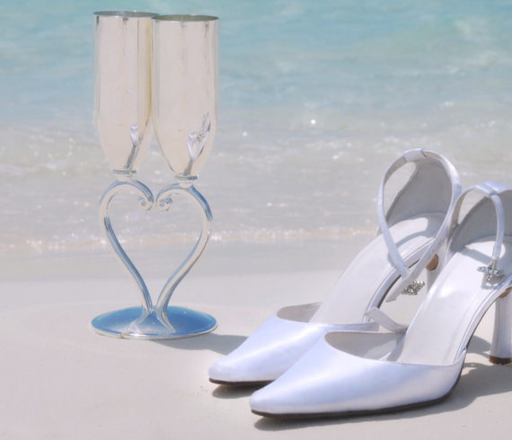Bridal Shoes and Bridal Champagne Glasses on the Beach